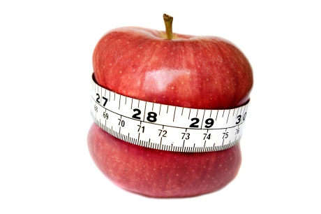 A stock photograph of an apple digitally manipulated toásuggest weight loss.